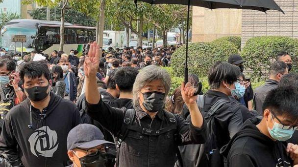 PHOTO: Some of the supporters outside court held up a three-finger Hunger Games salute, which is also used as symbol of resistance in Myanmar and Thailand. (ABC News)