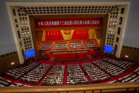 FILE - In this May 28, 2020, file photo, delegates and Chinese leaders attend the closing session of China's National People's Congress (NPC) in Beijing. The annual gathering of the National People's Congress and its advisory body, the Chinese People's Political Consultative Conference, brings handpicked delegates from across the country to discuss governing priorities and receive instructions from the ruling Communist Party leadership. (AP Photo/Mark Schiefelbein, File)