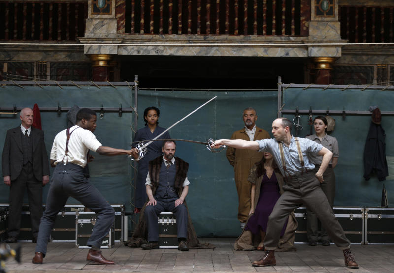 "Actors perform a scene from William Shakespeare's Hamlet for members of the media during a photo call to present Hamlet at Shakespeare's Globe theatre, London, Wednesday, April 23, 2014. Four centuries after his death, William Shakespeare is probably Britain's best-known export, his words and characters famous around the world. Shakespeare's Globe theater is setting out to test the Bard's maxim that ""all the world's a stage"" by taking ""Hamlet"" to every country on Earth world, more than 200 in all. (AP Photo/Lefteris Pitarakis)"