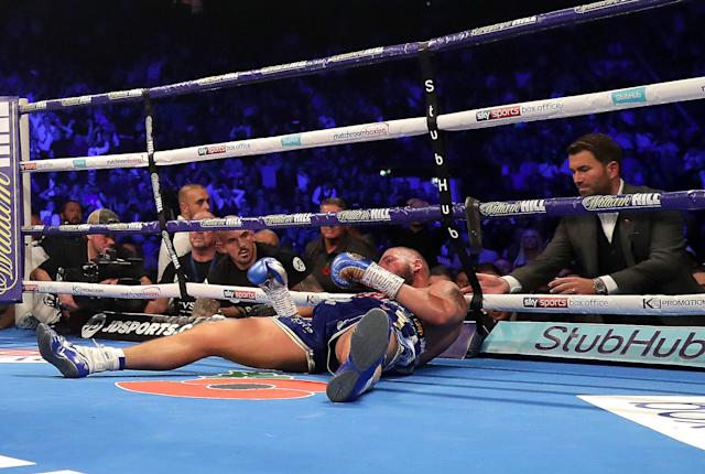 Eddie Hearn checks on Tony Bellew after he is knocked out by Oleksandr Usyk during a world cruiserweight title fight at Manchester Arena on Nov. 10, 2018 in Manchester, England. (Getty Images)