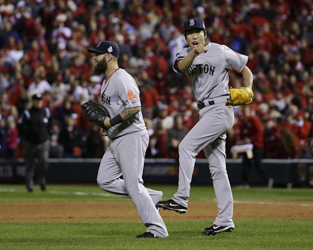 Boston Red Sox relief pitcher Koji Uehara, right celebrates with Mike Napoli after defeating the St. Louis Cardinals 4-2 in Game 4 of baseball's World Series Sunday, Oct. 27, 2013, in St. Louis. (AP Photo/Matt Slocum)
