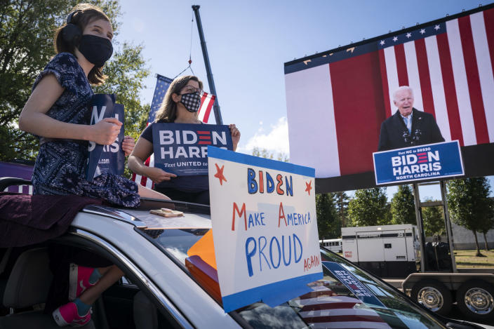 DURHAM, NC - OCTOBER 18: Supporters listen in their cars as Democratic presidential nominee Joe Biden speaks during a drive-in campaign rally at Riverside High School on October 18, 2020 in Durham, North Carolina. Biden is campaigning on Sunday in the battleground state that President Donald Trump won in 2016. (Photo by Drew Angerer/Getty Images)