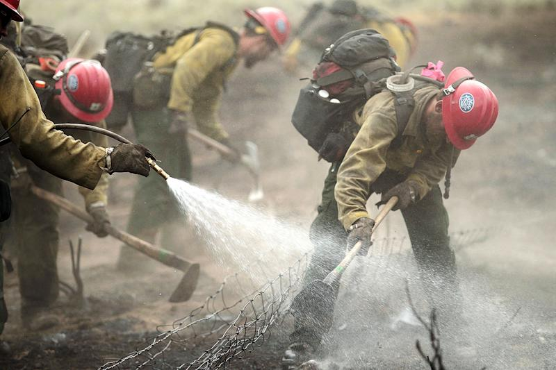 Members of the Prescott Hotshots mop up part of the Beaver Creek Fire on Saturday, Aug. 17, 2013 west of Hailey, Idaho.(AP Photo/Times-News, Ashley Smith) Mandatory Credit