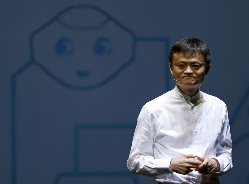 FILE PHOTO - Jack Ma, founder and executive chairman of China's Alibaba Group, speaks in front of a picture of SoftBank's human-like robot named 'pepper' during a news conference in Chiba