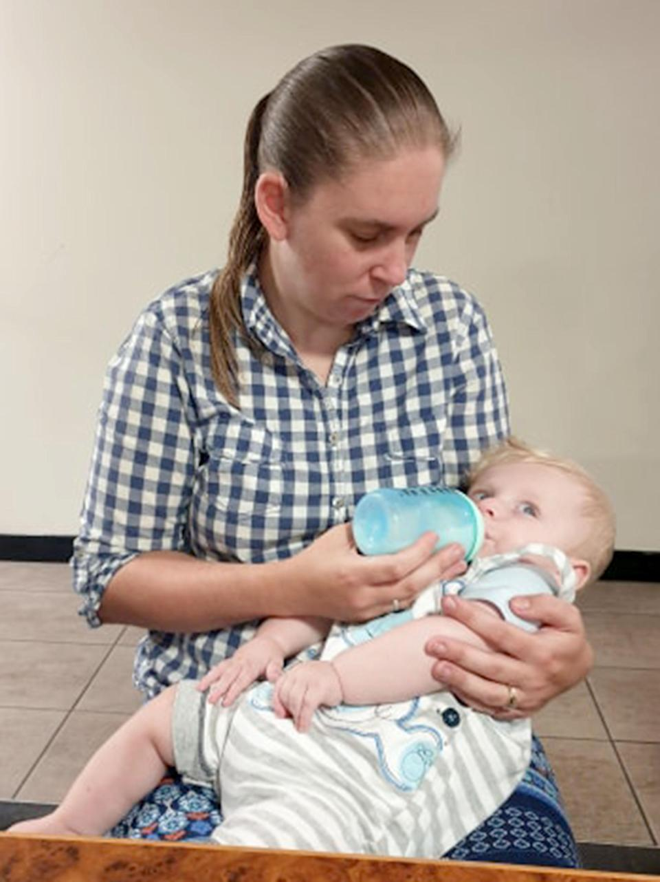 Joanne Campbell feeds her son Hayden with the help of other mums online Photo: Caters