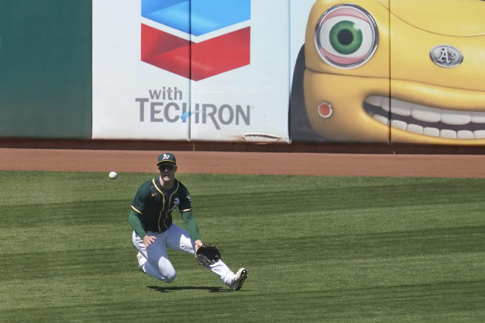 Oakland Athletics left fielder Mark Canha catches a line-out hit by Baltimore Orioles' Maikel Franco during the fifth inning of a baseball game in Oakland, Calif., Sunday, May 2, 2021. (AP Photo/Jeff Chiu)