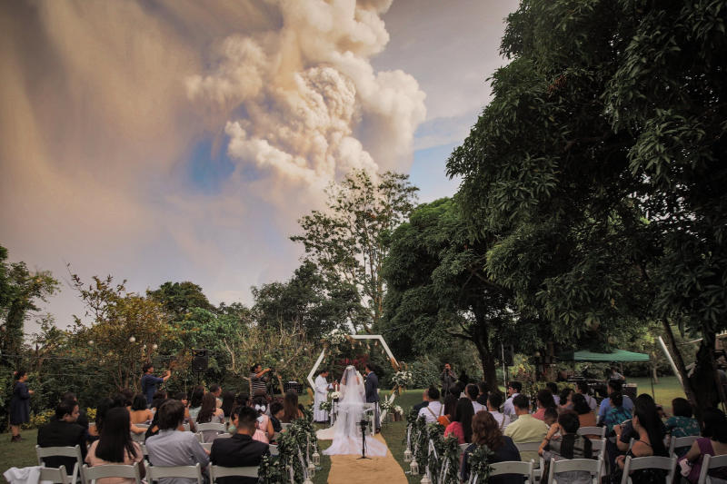Chino Vaflor and Kat Bautista Palomar who marry in Alfonso, Cavite in the Philippines a short distance from the Taal volcano eruption.