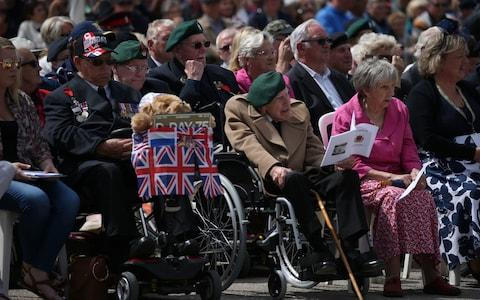 Veterans and their families in Arromanches - Credit: Jane Barlow/PA