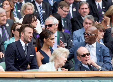 Jul 6, 2014; London, United Kingdom; Former soccer player David Beckham and wife Victoria Beckham talk with movie actor Samuel L. Jackson during the match between Novak Djokovic (SRB) and Roger Federer (SUI) on day 13 of the 2014 Wimbledon Championships at the All England Lawn and Tennis Club. Mandatory Credit: Susan Mullane-USA TODAY Sports