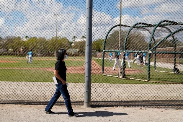Miami Marlins general manager Kim Ng walks around a field during spring training practice in Jupiter, Fla., in February.