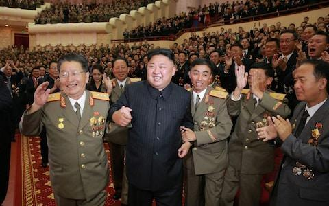Kim Jong-un congratulating the scientists behind his nuclear testsCredit: AFP