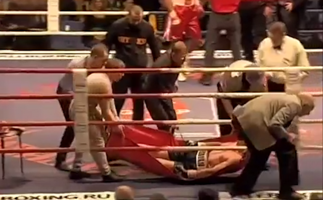 Roman Simakov is carried out of the ring on a makeshift stretcher.