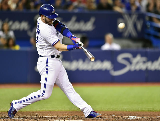 <p> FILE - In this Aug. 15, 2017, file photo, Toronto Blue Jays' Josh Donaldson hits a three-run home run against the Tampa Bay Rays during the fifth inning of a baseball game in Toronto. The hot corner figures to be smoking Friday, Jan. 12, 2018, when players and team swap proposed salaries in arbitration. Donaldson, Baltimore's Manny Machado, Washington's Anthony Rendon and the Chicago Cubs' Kris Bryant were among the more than 170 players headed to the exchange. (Frank Gunn/The Canadian Press via AP, File) </p>
