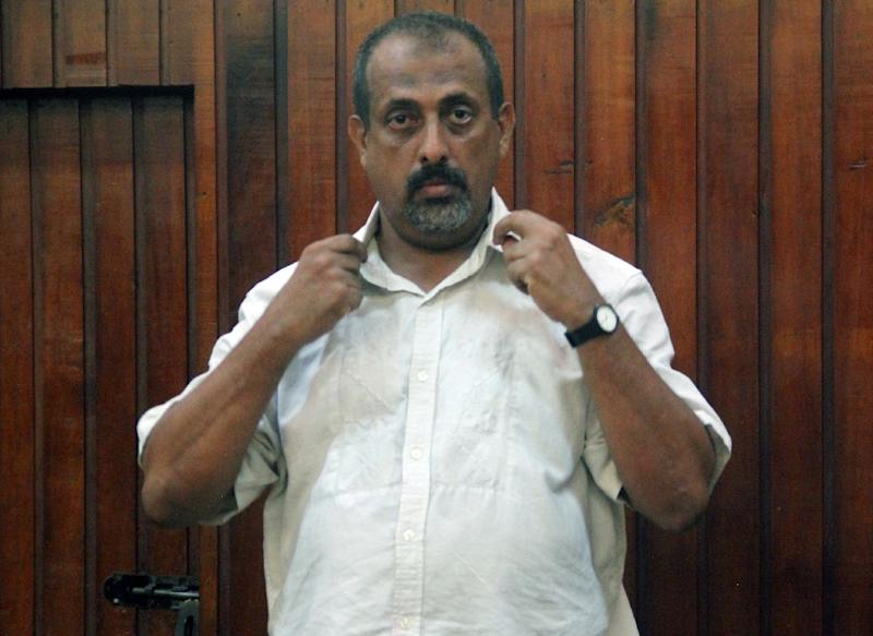 Kenyan national Feisal Mohammed Ali stands in the dock at a Mombasa court on December 24, 2014