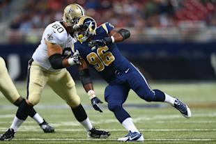 Michael Sam works against a Saints player. (Getty)