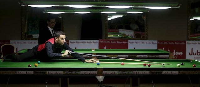Bahrain's Habib Subah plays a shot during his snooker match against Pakistan's Mohammad Majid Ali during the IBSF World 6 Red Snooker Championships in Karachi, Pakistan, August 10, 2015. REUTERS/Akhtar Soomro