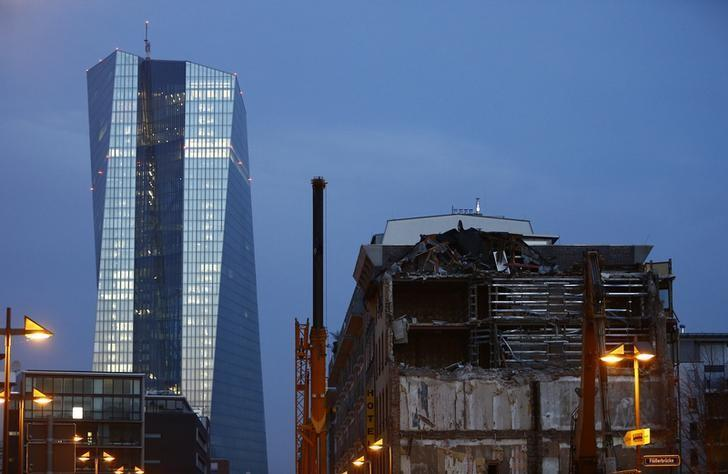 The new European Central Bank (ECB) headquarters are pictured behind partially dismantled Sudfass brothel club in Frankfurt