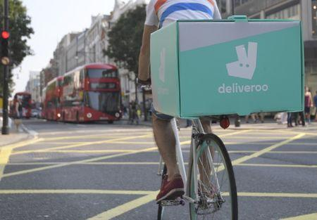 A cyclist delivers food for Deliveroo in London, Britain
