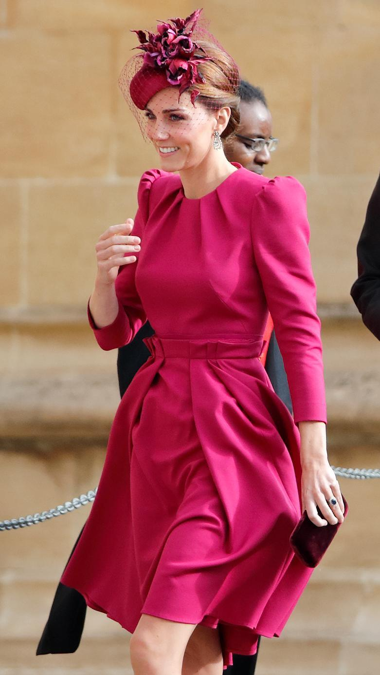 Kate Middleton wearing a magenta dress at Princess Eugenie's wedding. [Photo: Getty]