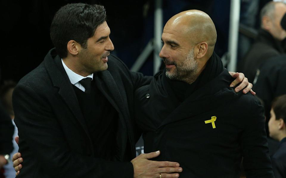 Shakhtar Donetsk's Portuguese manager Paulo Fonseca (1st-L) greets his opponent Manchester City's Spanish manager Pep Guardiola (2nd-L) prior to the UEFA Champions League group F football match between Shakhtar Donetsk and Manchester City, on December 6, 2017, at the Metalist stadium in Kharkiv, Eastern Ukraine. - GETTY IMAGES