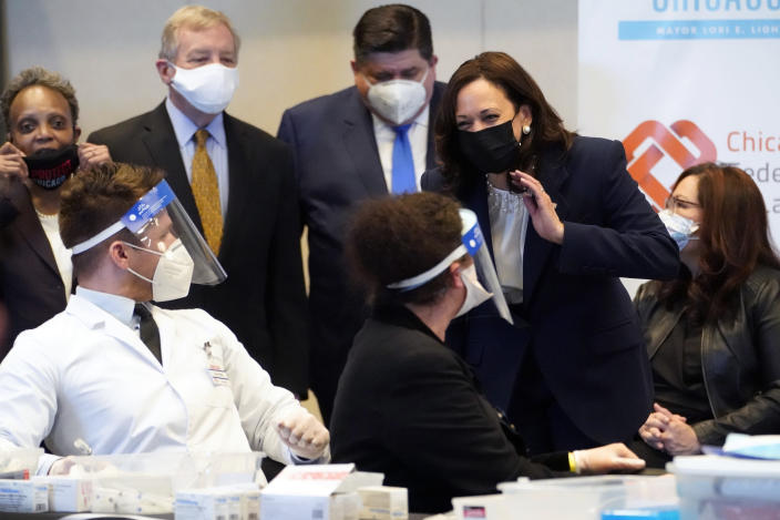 Vice President Kamala Harris speaks during visit to a COVID-19 vaccination site Tuesday, April 6, 2021, in Chicago. Listening are Chicago Mayor Lori Lightfoot, Sen. Dick Durbin, D-Ill., Illinois Gov. J.B. Pritkzer and Sen. Tammy Duckworth, D-Ill., right. The site is a partnership between the City of Chicago and the Chicago Federation of Labor. (AP Photo/Jacquelyn Martin)