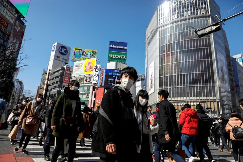 People wearing protective masks are seen in the Shibuya shopping district in Tokyo