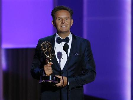 "Producer Mark Burnett accepts the award for Outstanding Reality - Competition Program for ""The Voice"" at the 65th Primetime Emmy Awards in Los Angeles"