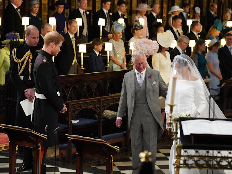 Meghan Markle is accompanied by Prince Charles down the aisle at St George's Chapel in Windsor Castle, 19 May 2018: JONATHAN BRADY/AFP via Getty Images