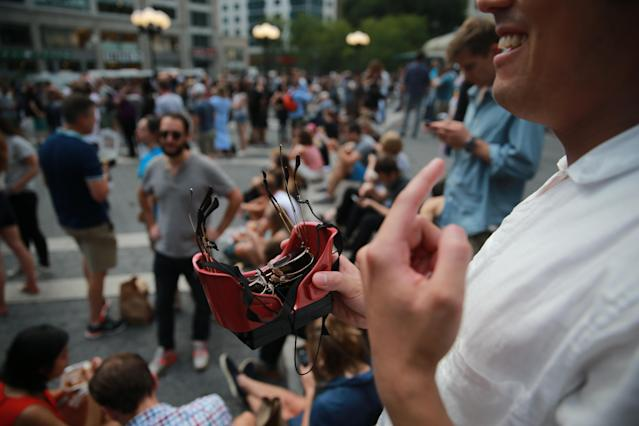<p>A man shows off his specially made goggles to watch the total solar eclipse in Union Square, New York City, on Aug. 21, 2017. (Gordon Donovan/Yahoo News) </p>