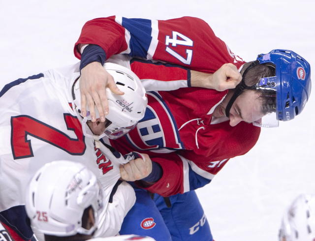 Washington Capitals defenseman Matt Niskanen (2) and Montreal Canadiens left wing Kenny Agostino (47) wrestle during first-period NHL hockey game action Monday, Nov. 19, 2018, in Montreal. (Ryan Remiorz/The Canadian Press via AP)