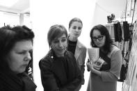 <p>Otto and Marni designer Consuelo Castiglioni walks Suzy Menkes, left, and another editor through the show's collection of inspirations backstage.</p>