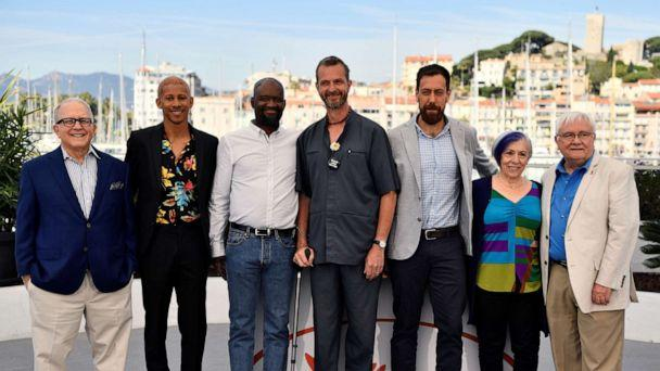 PHOTO: Guy Vendenberg, center, stands with reporter Hank Plante, actor Keiynan Lonsdale, Steve Williams, Dan Krauss, Alison Moed and Cliff Morrison during a photocall for the film '5B' at Cannes Film Festival in Cannes, southern France, on May 16, 2019. (Christophe Simon/AFP/Getty Images)