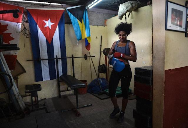 Cuban boxer Idamelys Moreno prepares for training in a Havana gym on May 14, 2019. (AFP Photo/YAMIL LAGE)