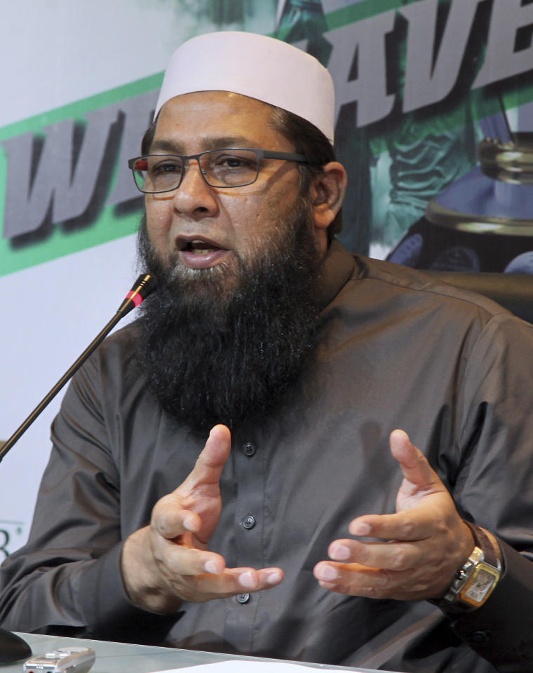 Chief selector of Pakistan Cricket Board Inzamam-ul-Haq announces the World Cup cricket squad in Lahore, Pakistan, Monday, May 20, 2019. Experienced fast bowlers Mohammad Amir and Wahab Riaz were brought back into Pakistan's 15-man World Cup squad on Monday following a loss to England in the one-day series. (AP Photo/K.M. Chaudary)