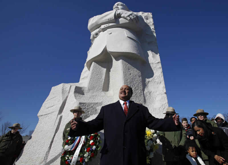 "FILE - In this Sunday, Jan. 15, 2012 file photo, Martin Luther King III, center, the son of civil rights leader Martin Luther King Jr., speaks during a ceremony at the Martin Luther King Jr. Memorial, in Washington, in observance of the slain civil rights leader's 83rd birthday anniversary. Martin Luther King III believes that one day we will be able to live every word of his father's dream. ""I think my father's vision was that we should at some point have a colorblind society,"" he says. ""He always was challenging us to be the best nation we could be."" (AP Photo/Jacquelyn Martin, File)"