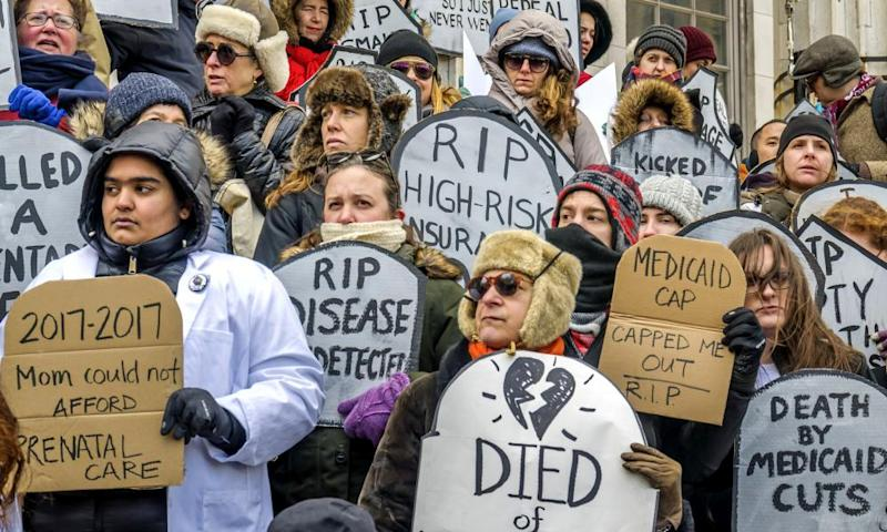 Activists rally in Brooklyn in defense of the Affordable Care Act.