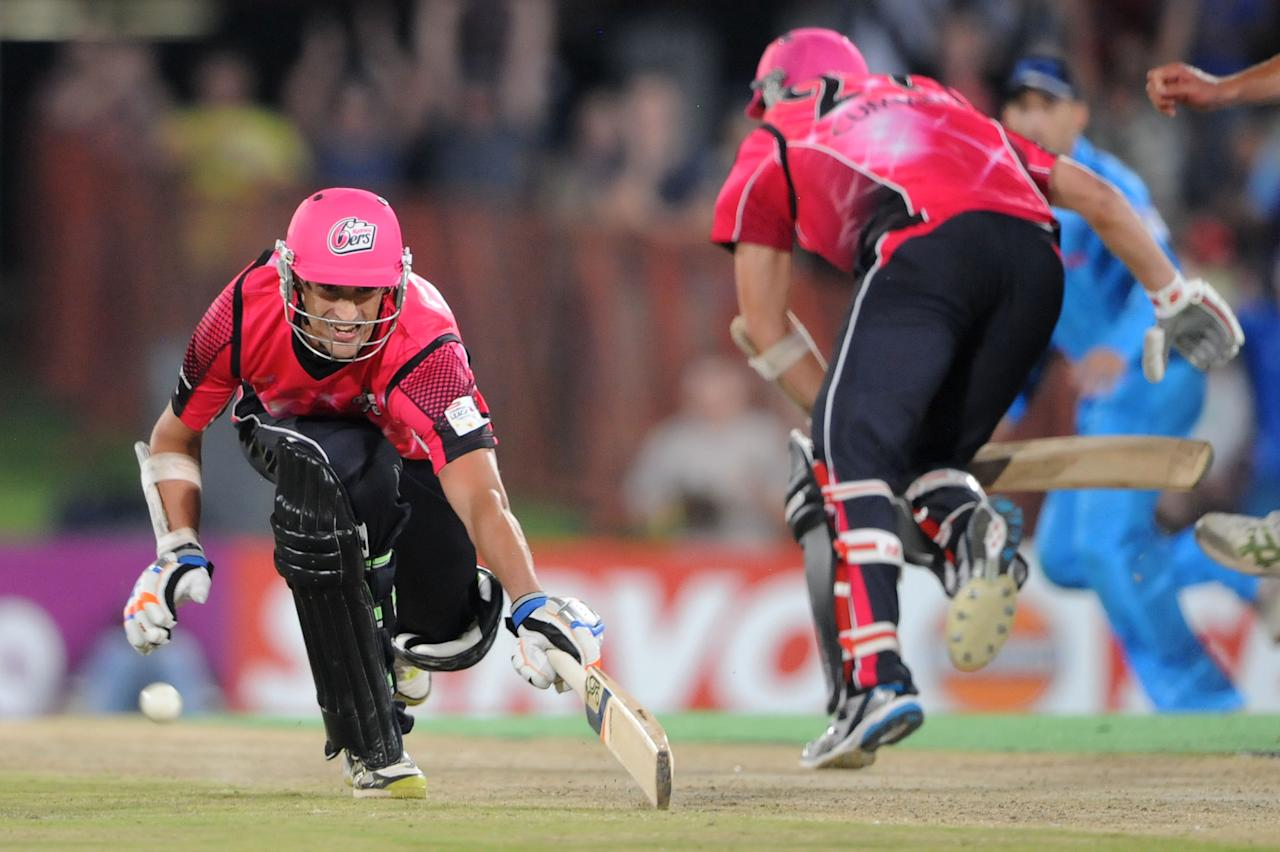 PRETORIA, SOUTH AFRICA - OCTOBER 26: (SOUTH AFRICA OUT) Mitchell Starc of Sydney Sixers dives to make the winning run during the Karbonn Smart CLT20 Semi Final match between Nashua Titans and Sydney Sixers at SuperSport Park on October 26, 2012 in Pretoria, South Africa. (Photo by Lee Warren/Gallo Images/Getty Images)