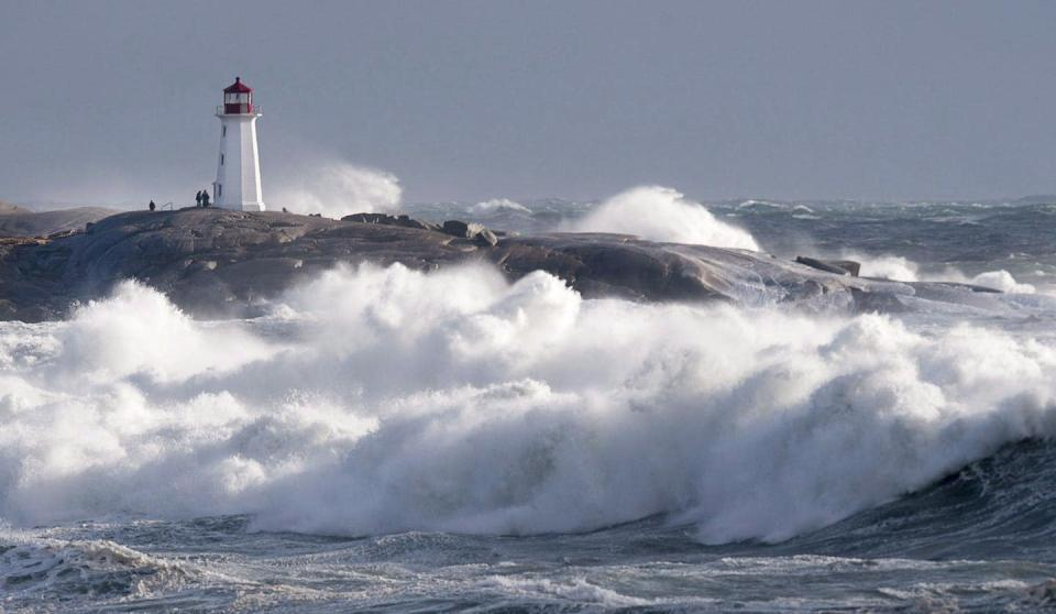 """<span class=""""caption"""">Waves pound the shore at Peggy's Cove, N.S. in January 2018. </span> <span class=""""attribution""""><span class=""""source"""">THE CANADIAN PRESS/Andrew Vaughan</span></span>"""