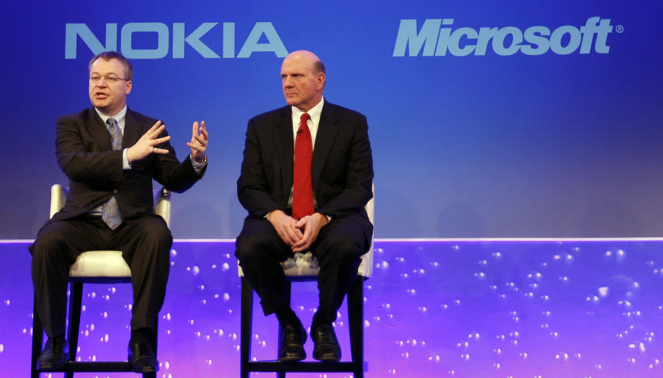 File-This Feb. 11, 2011 file photo shows Stephen Elop CEO of Nokia, left, with CEO of Microsoft Steve Ballmer, speaking in London, as he announces the strategic partnership with Microsoft. Microsoft says it is buying Nokia's devices and services business, and getting access to the company's patents, for a total of 5.44 billion euros ($7.2 billion) in an effort to expand its share of the smartphone market. Nokia confirmed the deal in a joint news release from the two companies Monday Sept. 2, 2013. (AP Photo/Alastair Grant, File)