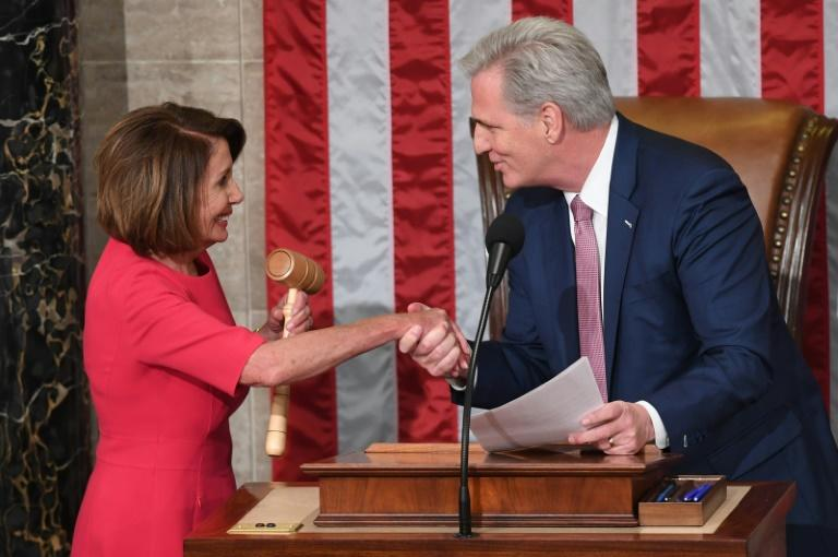 Democratic House Speaker Nancy Pelosi shakes hands with Republican Minority Leader Kevin McCarthy, whom she defeated in a floor vote (AFP Photo/SAUL LOEB)