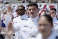 Cadet Daniel Christopher Phillips, left, stands with other cadets during the commencement for the United States Coast Guard Academy in New London, Conn., Wednesday, May 19, 2021. (AP Photo/Andrew Harnik)