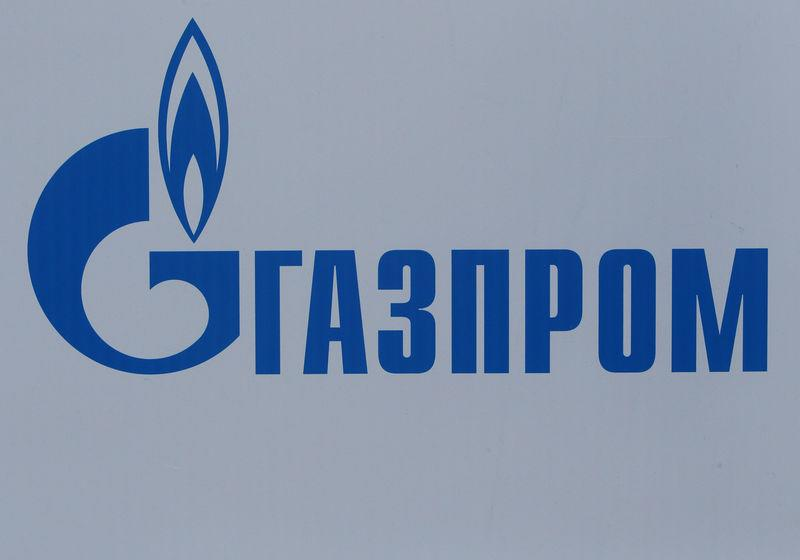 FILE PHOTO: The logo of Russian gas giant Gazprom is seen on a board at the SPIEF 2017 in St. Petersburg