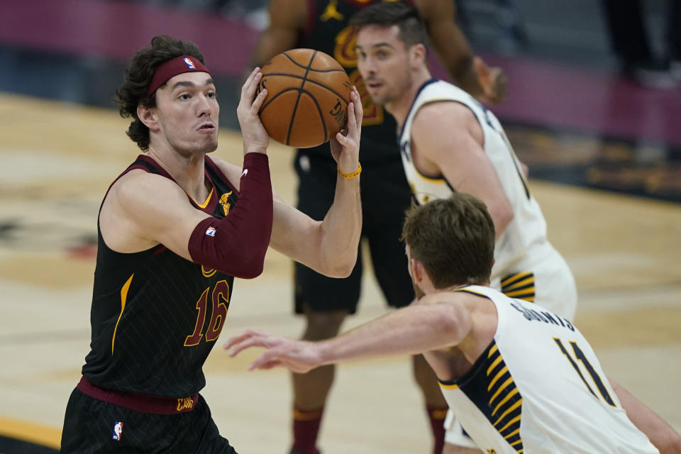 Cleveland Cavaliers' Cedi Osman (16) drives to the basket against Indiana Pacers' Domantas Sabonis (11) during the first half of an NBA basketball game Wednesday, March 3, 2021, in Cleveland. (AP Photo/Tony Dejak)