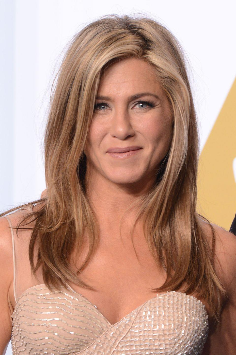 """<p>Jen looked stunning at the 87th Academy Awards thanks to her <a href=""""https://www.goodhousekeeping.com/beauty/hair/news/g2443/blonde-hair-color-ideas/"""" rel=""""nofollow noopener"""" target=""""_blank"""" data-ylk=""""slk:pastel-y blonde hair"""" class=""""link rapid-noclick-resp"""">pastel-y blonde hair</a> that paired beautifully with her sparkly champagne gown.</p>"""
