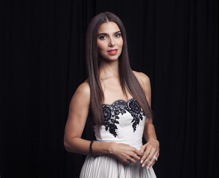 """This June 19, 2013 photo shows actress Roselyn Sanchez in New York. Sanchez stars in the series, """"Devious Maids,"""" airing Sundays at 10 p.m. EST on Lifetime. (Photo by Taylor Jewell/Invision/AP)"""