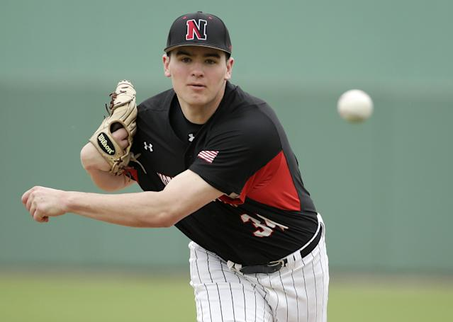 Northeastern's James Mulry delivers a warm-up pitch in the fourth inning of an exhibition baseball game against the Boston Red Sox, Thursday, Feb. 27, 2014, in Fort Myers, Fla. (AP Photo/Steven Senne