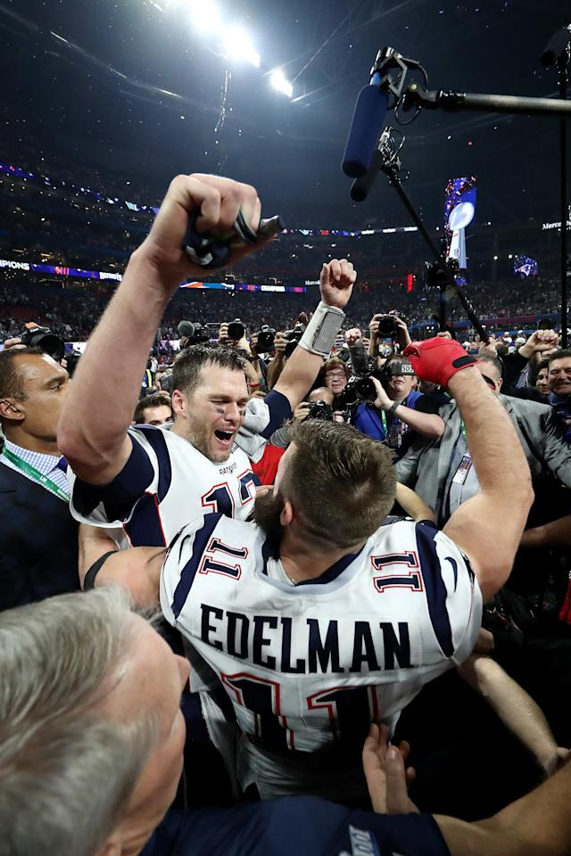 <p>Tom Brady #12 of the New England Patriots and Julian Edelman #11 celebrate their teams 13-3 win over the Los Angeles Rams during Super Bowl LIII at Mercedes-Benz Stadium on February 03, 2019 in Atlanta, Georgia. (Photo by Al Bello/Getty Images) </p>