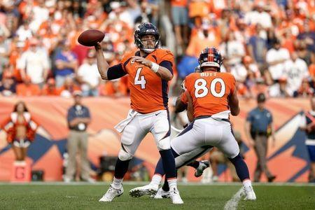 Sep 16, 2018; Denver, CO, USA; Denver Broncos tight end Jake Butt (80) defends as quarterback Case Keenum (4) drops back to pass in the fourth quarter against the Oakland Raiders at Broncos Stadium at Mile High. Mandatory Credit: Isaiah J. Downing-USA TODAY Sports