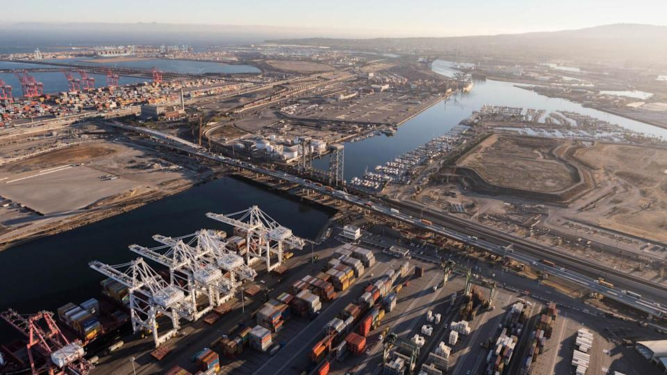 Los Angeles, California, USA - August 16, 2016: Aerial view of port cranes, containers and cargo facilities in Wilmington and Terminal Island.
