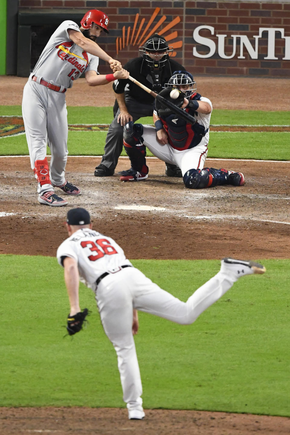 St. Louis Cardinals third baseman Matt Carpenter (13) hits against the Atlanta Braves in the eighth inning during Game 1 of a best-of-five National League Division Series, Thursday, Oct. 3, 2019, in Atlanta. (AP Photo/Scott Cunningham)